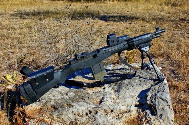 A M1a rifle resting on a bipod.