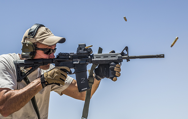 A man firing an AR-15 with Federal ammunition.