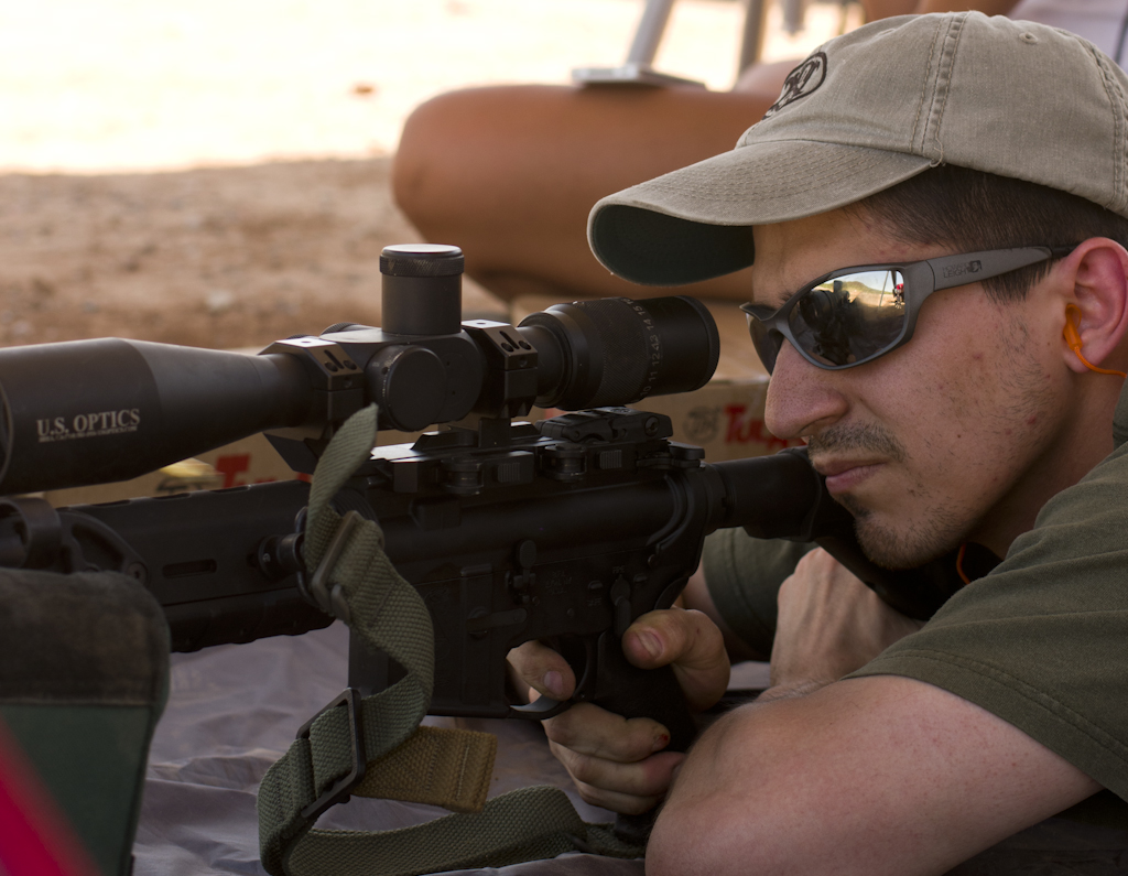 A Marine infantryman and marksmanship instructor prepares to test accuracy.